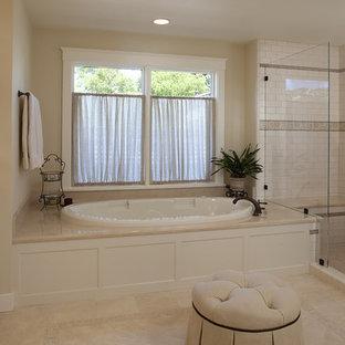 Ejemplo de cuarto de baño tradicional con lavabo bajoencimera, armarios con paneles con relieve, puertas de armario blancas, bañera encastrada, ducha empotrada, baldosas y/o azulejos blancos, baldosas y/o azulejos de cemento y encimeras beige