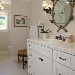 Photo of a traditional bathroom in San Francisco with tile benchtops and beige walls.