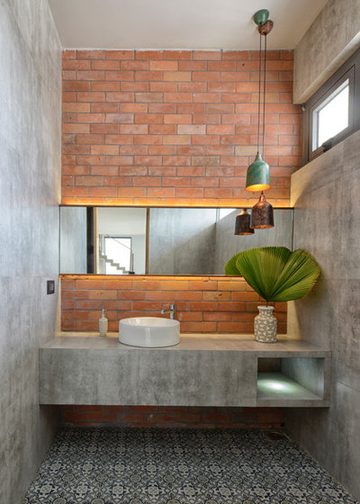 Industrial Bathroom by S A K Designs