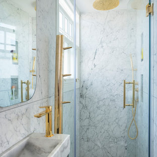 Inspiration for a small traditional bathroom in London with marble tiles, grey walls, marble flooring, a pedestal sink and white floors.