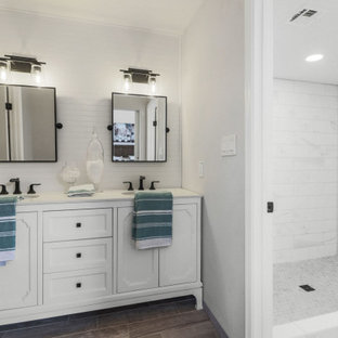 This is an example of a transitional bathroom in Phoenix with white cabinets, an alcove shower, white tile, white walls, wood-look tile, brown floor, white benchtops, a double vanity, a freestanding vanity, recessed-panel cabinets, marble, an undermount sink and a hinged shower door.