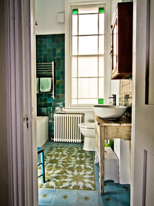 Photo of a large eclectic bathroom in Sussex with a vessel sink,  freestanding cabinets,