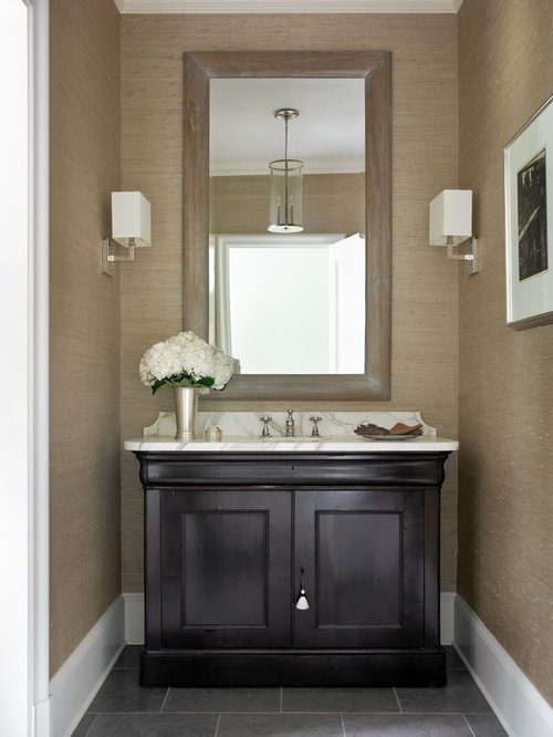 1 173 bath design photos with dark wood cabinets and brown walls