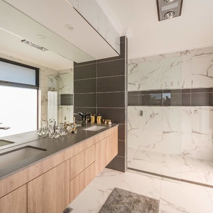This is an example of a contemporary master bathroom in Other with flat-panel cabinets, light wood cabinets, a curbless shower, an undermount sink, white floor, an open shower and grey benchtops.