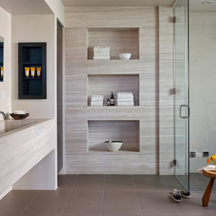 Wet room - small contemporary master limestone tile ceramic tile and gray floor wet room idea in Los Angeles with a trough sink, a hinged shower door and limestone countertops