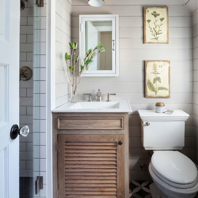Small country 3/4 white tile and subway tile multicolored floor bathroom photo in Denver with a two-piece toilet, a hinged shower door, white countertops, furniture-like cabinets, light wood cabinets, beige walls and an integrated sink