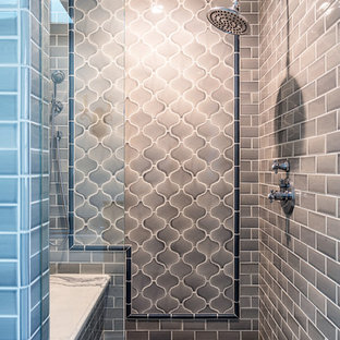 Bathroom - mid-sized transitional master gray tile and mosaic tile mosaic tile floor bathroom idea in Los Angeles with shaker cabinets, medium tone wood cabinets, beige walls, an undermount sink, granite countertops, a hinged shower door and white countertops