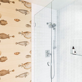 Mid-sized mid-century modern white tile and porcelain tile alcove shower photo in Portland with a hinged shower door
