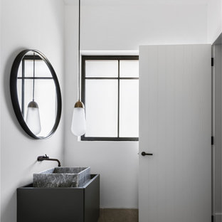 Mid-sized contemporary bathroom in Sydney with flat-panel cabinets, black cabinets, white walls, a vessel sink, grey floor, grey benchtops, a single vanity and a floating vanity.