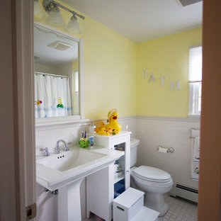 Example of a classic mosaic tile white floor bathroom design in New York with a pedestal sink and yellow walls
