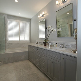 Example of a mid-sized transitional master white tile and porcelain tile porcelain tile and gray floor bathroom design in Orange County with beaded inset cabinets, gray cabinets, a one-piece toilet, gray walls, an undermount sink and quartz countertops