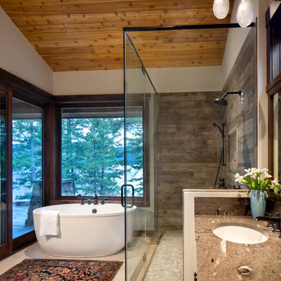 Mountain style brown tile beige floor bathroom photo in Other with white walls, an undermount sink, a hinged shower door and brown countertops