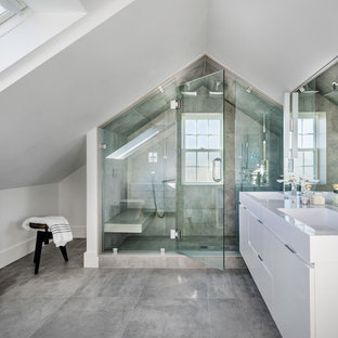 Double shower - mid-sized contemporary master gray tile and porcelain tile gray floor and porcelain floor double shower idea in Boston with flat-panel cabinets, white cabinets, white walls, an integrated sink and a hinged shower door