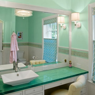 Example of a transitional white tile bathroom design in Cincinnati with a vessel sink, white cabinets, green walls and green countertops