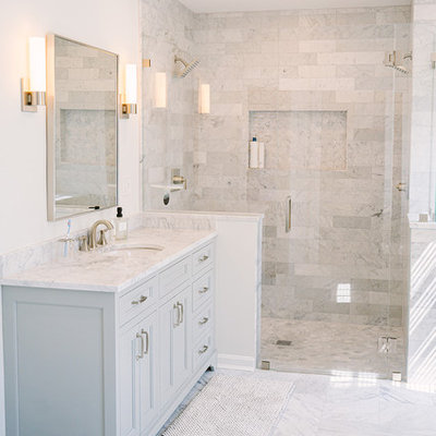 Large transitional master gray tile and marble tile marble floor and gray floor walk-in shower photo in Cincinnati with recessed-panel cabinets, gray cabinets, white walls, an undermount sink, marble countertops, a hinged shower door and gray countertops