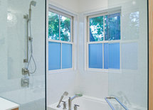What tile was used for the shower and bathtub surround?  On the floor?