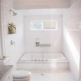 Example of a classic white tile and subway tile bathroom design in San Diego with an undermount sink and white cabinets