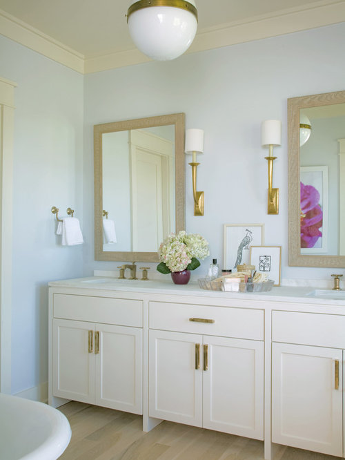 ... bathroom photo in Charleston with shaker cabinets and white cabinets