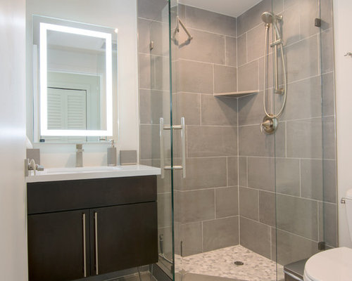example of a small minimalist 34 porcelain floor and gray floor corner shower design