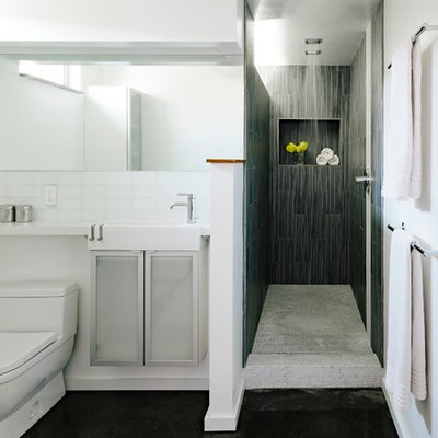 Inspiration for a modern gray tile and glass tile bathroom remodel in Portland with glass-front cabinets