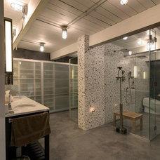 Industrial Bathroom by Ransom Real Estate LLC