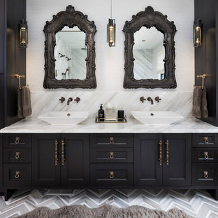 Example of a tuscan master multicolored floor bathroom design in Minneapolis with recessed-panel cabinets, black cabinets, white walls and a vessel sink