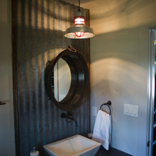 Industrial Bathroom by Barn Light Electric Company