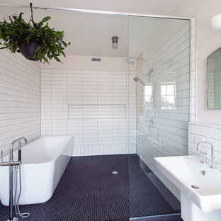 Inspiration for a large industrial master white tile and subway tile ceramic tile bathroom remodel in Philadelphia with a wall-mount sink, a two-piece toilet and white walls
