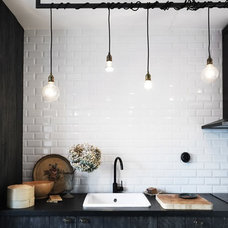 Industrial Bathroom by ReNew Design