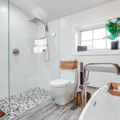 Example of a mid-sized trendy master black and white tile and ceramic tile ceramic tile bathroom design in New York with recessed-panel cabinets, gray cabinets, a one-piece toilet, gray walls, an undermount sink and granite countertops