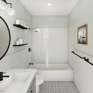 На фото: ванная комната в стиле лофт с серыми фасадами, желтой плиткой, керамической плиткой, зелеными стенами, полом из цементной плитки, врезной раковиной, столешницей из искусственного кварца, серым полом и белой столешницей с