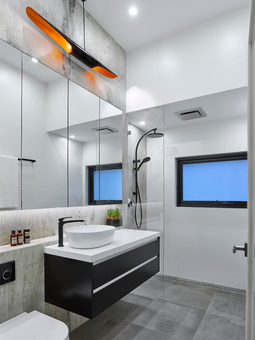 small contemporary bathroom in adelaide with flat panel cabinets black cabinets a wall