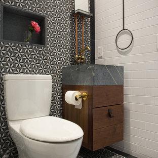Idee per una piccola stanza da bagno con doccia moderna con lavabo rettangolare, ante lisce, ante in legno scuro, top in saponaria, WC monopezzo, piastrelle multicolore, piastrelle a mosaico, pareti multicolore e pavimento con piastrelle in ceramica