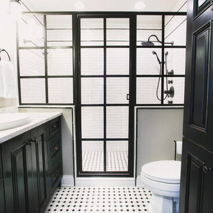 Design ideas for a mid-sized industrial master wet room bathroom in Other with recessed-panel cabinets, black cabinets, a two-piece toilet, marble, grey walls, laminate floors, a drop-in sink, multi-coloured floor and a hinged shower door.