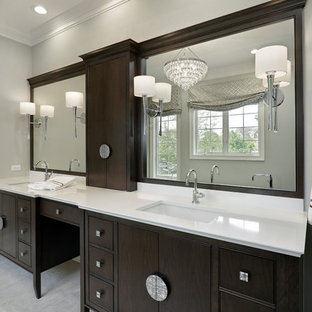 Mid-sized trendy master porcelain tile ceramic tile bathroom photo in Chicago with flat-panel cabinets, brown cabinets, quartz countertops, a hinged shower door, gray walls and an undermount sink