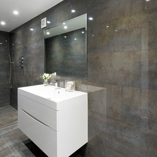 Inspiration for a contemporary brown tile walk-in shower remodel in London with flat-panel cabinets, white cabinets and brown walls