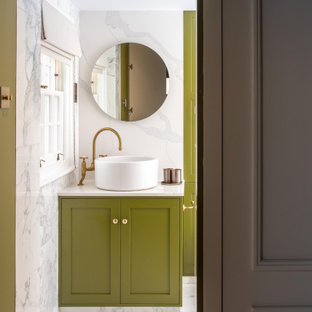 Design ideas for a large contemporary master bathroom in London with shaker cabinets, green cabinets, an open shower, a wall-mount toilet, white tile, marble, green walls, marble floors, a vessel sink, marble benchtops, white floor, an open shower, white benchtops, a single vanity, a built-in vanity and panelled walls.