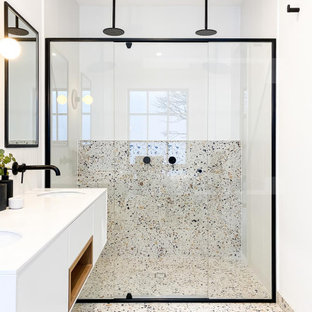 Inspiration for a contemporary shower room bathroom in Melbourne with flat-panel cabinets, white cabinets, a built-in shower, grey tiles, white walls, a submerged sink, grey floors, a sliding door, white worktops, double sinks and a floating vanity unit.