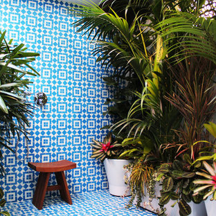 Inspiration for a tropical blue tile bathroom remodel in Los Angeles