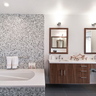 Inspiration for a contemporary gray tile and mosaic tile tub/shower combo remodel in Los Angeles with an undermount sink, flat-panel cabinets, dark wood cabinets and an undermount tub
