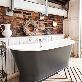 Inspiration for a shabby-chic style freestanding bathtub remodel in Manchester with multicolored walls