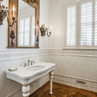 Inspiration for a timeless white tile medium tone wood floor bathroom remodel in Dallas with a console sink and white walls