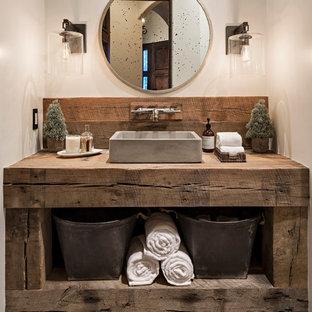 Foto de cuarto de baño con ducha, rural, de tamaño medio, con armarios tipo mueble, puertas de armario con efecto envejecido, sanitario de dos piezas, baldosas y/o azulejos blancas y negros, baldosas y/o azulejos de cemento, paredes blancas, suelo de azulejos de cemento, lavabo sobreencimera y encimera de madera