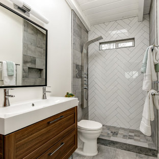 Alcove shower - small modern master white tile and subway tile porcelain floor alcove shower idea in San Diego with furniture-like cabinets, medium tone wood cabinets, a two-piece toilet, white walls, an integrated sink and solid surface countertops