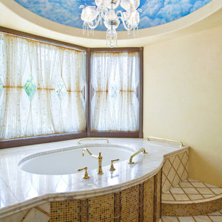 Photo of a mediterranean bathroom in San Luis Obispo with a submerged bath, multi-coloured tiles, mosaic tiles, yellow walls and dark hardwood flooring.