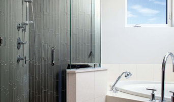 Island Stone Smoke Linear Glass Tile Shower with Pebble Tile Floor