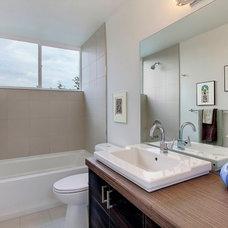 Modern Bathroom by Abodian Inc