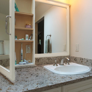 Bathroom - large traditional master beige tile and porcelain tile porcelain floor bathroom idea in Seattle with a drop-in sink, raised-panel cabinets, white cabinets, engineered quartz countertops, a two-piece toilet and white walls