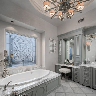 This is an example of an expansive mediterranean bathroom in Phoenix with grey walls, porcelain flooring and brown floors.