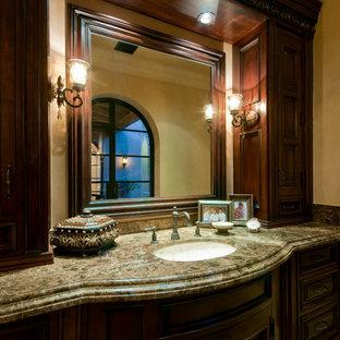 Imagen de cuarto de baño principal, mediterráneo, extra grande, con armarios tipo mueble, puertas de armario marrones, bañera exenta, ducha empotrada, sanitario de una pieza, baldosas y/o azulejos multicolor, baldosas y/o azulejos con efecto espejo, paredes multicolor, suelo de travertino, lavabo sobreencimera, encimera de granito, suelo multicolor, ducha abierta y encimeras multicolor
